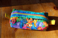 https://cherishedneedlecreations.wordpress.com/2013/11/04/serger-zippered-pouch-tutorial/