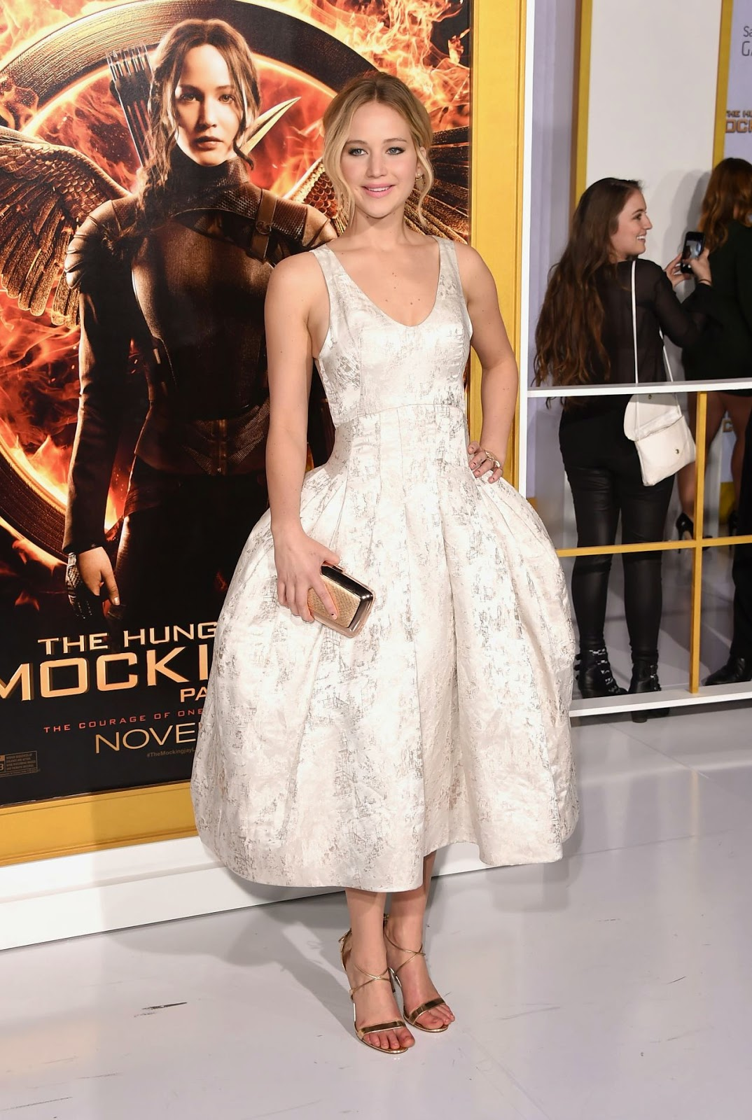 Jennifer Lawrence is charming in Christian Dior Couture at The Hunger Games: Mockingjay Part 1 LA premiere