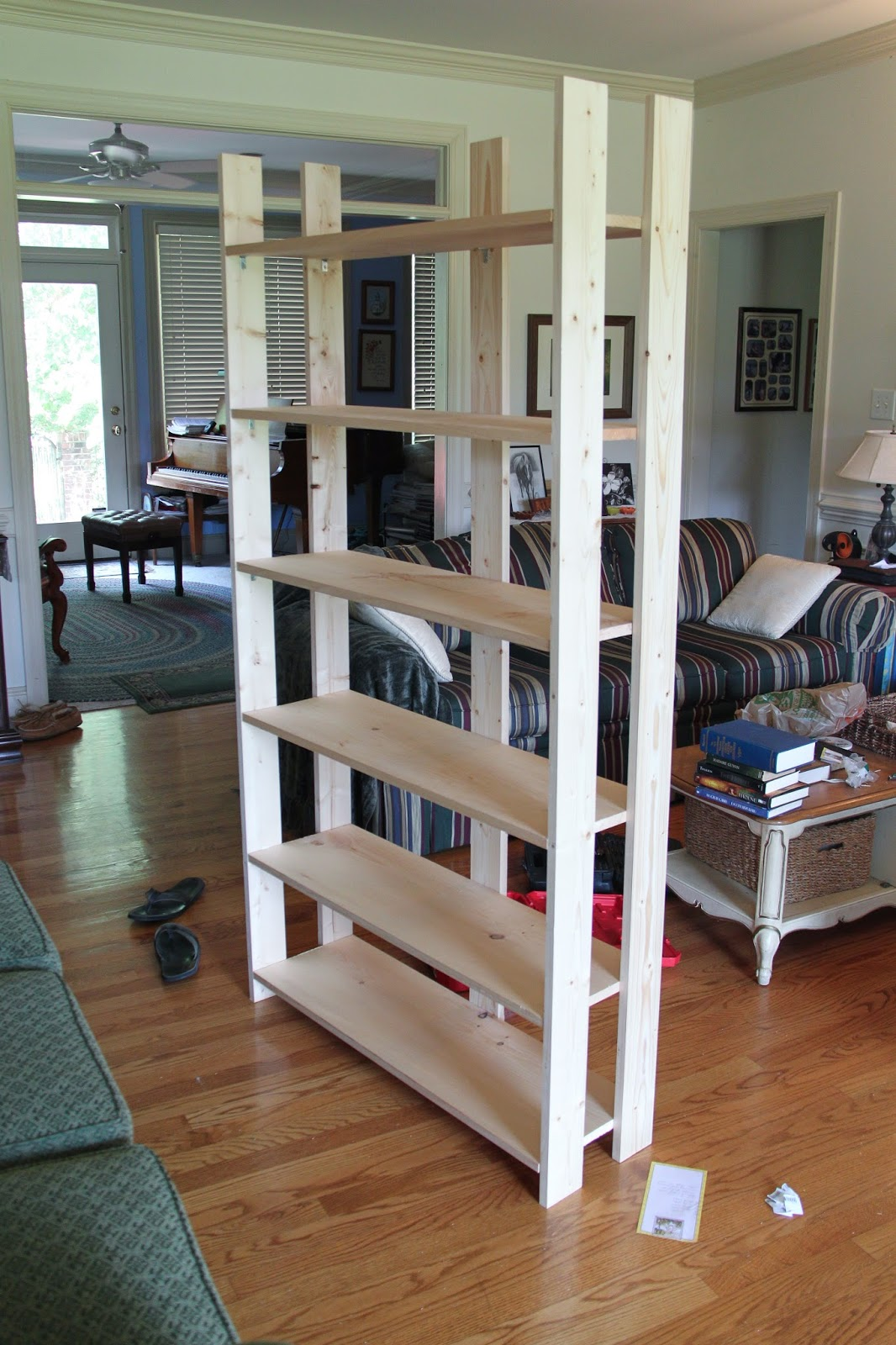 completed bookcase built in the living room - Build Your Own Bookshelves