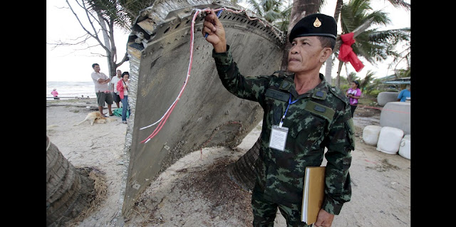 A Thai soldier inspected the piece of metal Sunday. Credit: Reuters
