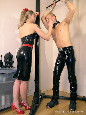 Rubber Clad Mistress taunting her slave at the english mansion