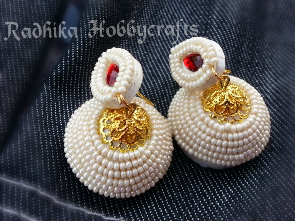 drop shape kundan stone in the top stud and done with my Jhumkas