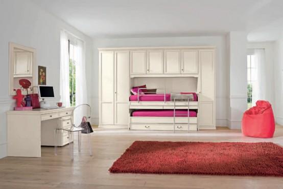 en la decoracin de esta habitacin para nia se ha optado por el color rojo como complemento a los muebles de color rosa le da fuerza al ambiente a la par