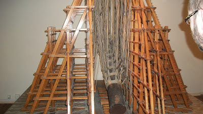 A model of the scaffolding that was used to raise the massive column in the courtyard of the Hermitage.