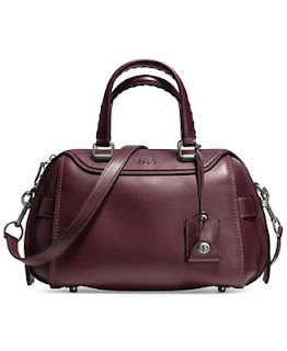 a0a39b864691 The bag featured in this commercial was the Coach Ace Satchel in Glove  Tanned Leather. The color of the bag in the short clip was Burgundy.