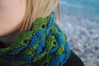 Girl with beautiful crochet wavy scarf in blue and green