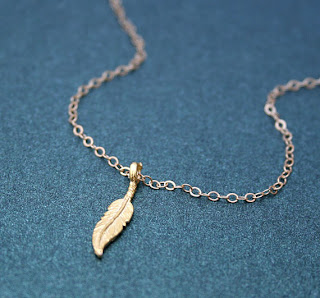 Gold feather necklace by Amanda Dear Etsy