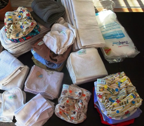 Zestaw pieluszek wielorazowych dla dwójki dzieci. Pieluszki kieszonki, otulacze, wełniane, pul