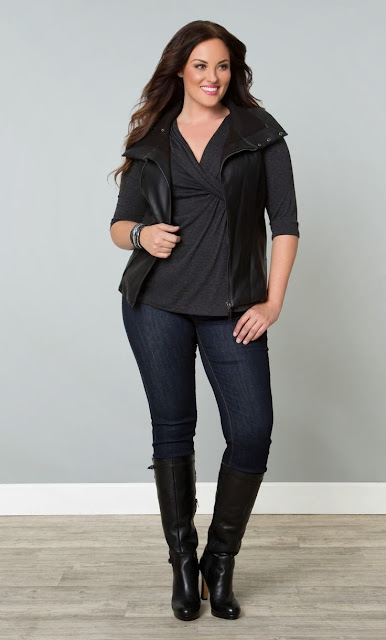 jeans with black shirt and sleeveless jacket