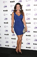 Kelly Brook hot in a tigh tblue dress