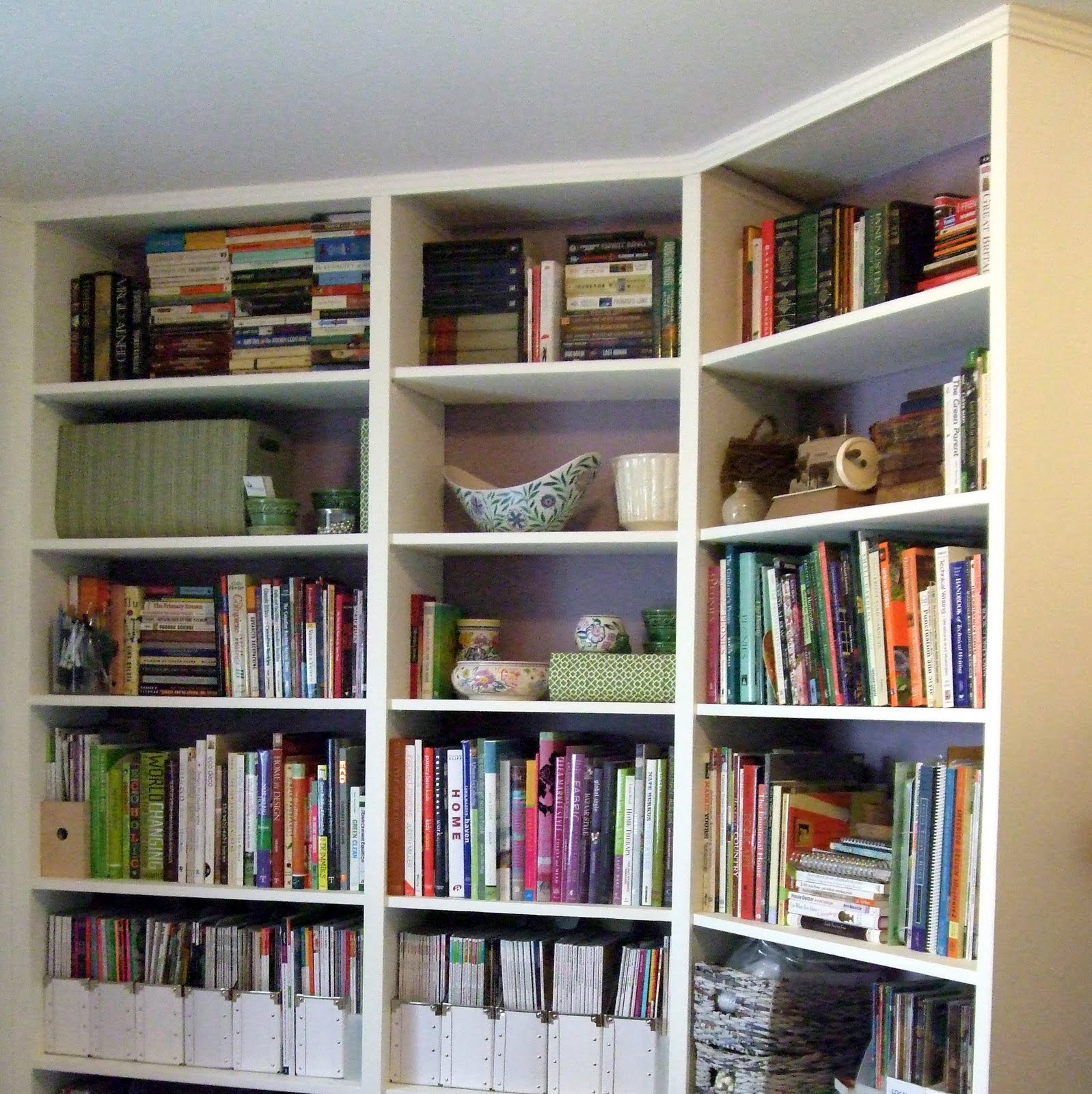 Amazing photo of These floor to ceiling shelves are in an open home office space that  with #927239 color and 1598x1600 pixels