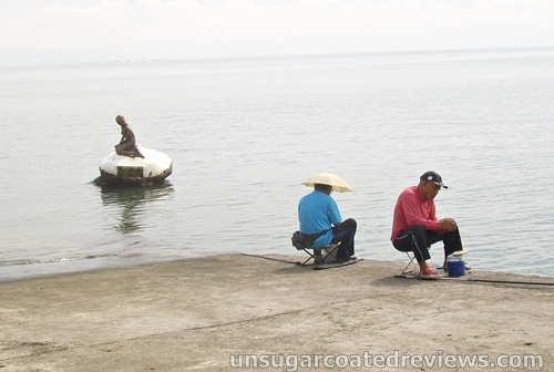 closer shot of the two men fishing