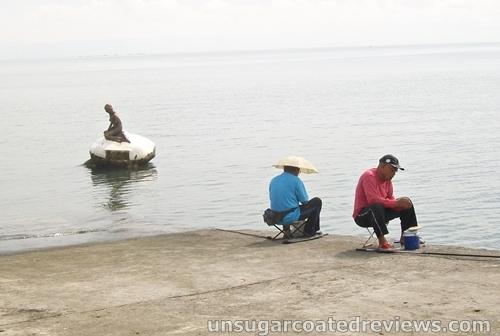 closer shot of the two men fishing