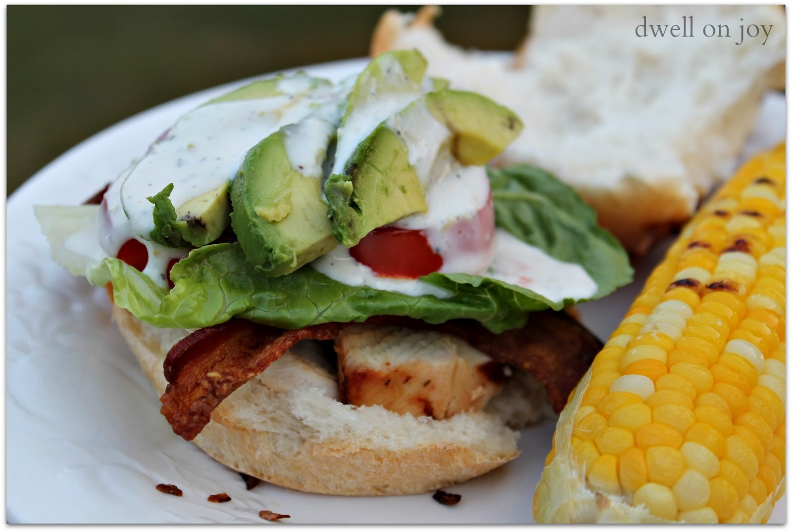 Simply slice grilled chicken and place it on a roll bottom. Top with ...