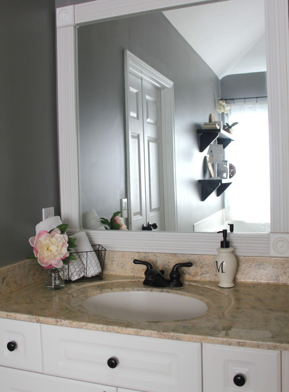 My enroute life framimg our master bathroom builder grade for Large flat bathroom mirrors