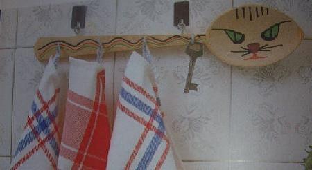Colgador de manteles para la cocina for Colgador de perchas