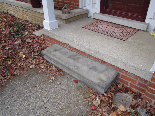 New brick paver step replaces old concrete step at porch for Cleaning concrete steps