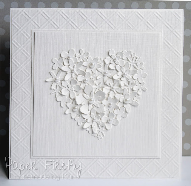 White on white card featuring heart made of tiny flowers