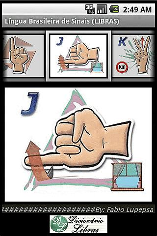 descrição da imagem: tela do aplicativo. Em cima esta escrito LÍNGUA BRASILEIRA DE SINAIS. LIBRAS. abaixo, três quadros. um ao lado do outro. em cada um deles o desenho de uma mão fazendo o sinal de uma letra.No caso I, J, K. ao lado do desenho letra J uma janela. Ao lado do desenho da letra K, uma placa que simboliza quilometro. Abaixo desses três quadros, um quadro maior com a reprodução do desenho da mão fazendo o sinal do J e o desenho da Janela.  Em baixo um quadrado onde se lê Dicionário de Libras, o qual leva direto para um site. Fim da descrição.