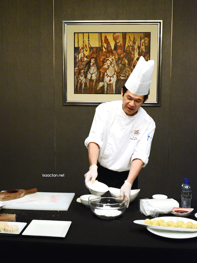 The chef demonstrating how to make the mooncakes