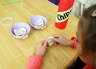 "Tessa pulled paper potato chips from the ""Chips"" can, read the sentences and then placed them into the proper punctuation dip bowls."