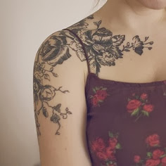 Bundles of black leaves tattoo on shoulder