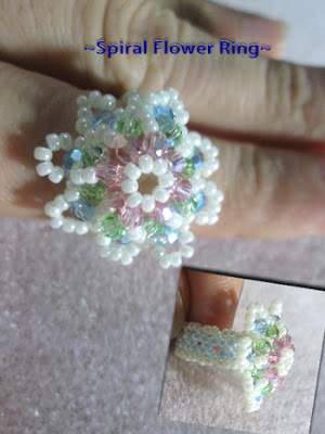 Spiral_flower_ring_with_round _Swarovski_crystals