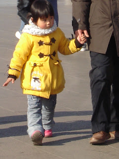 Little Empress wearing a yellow coat, Beijing 2008