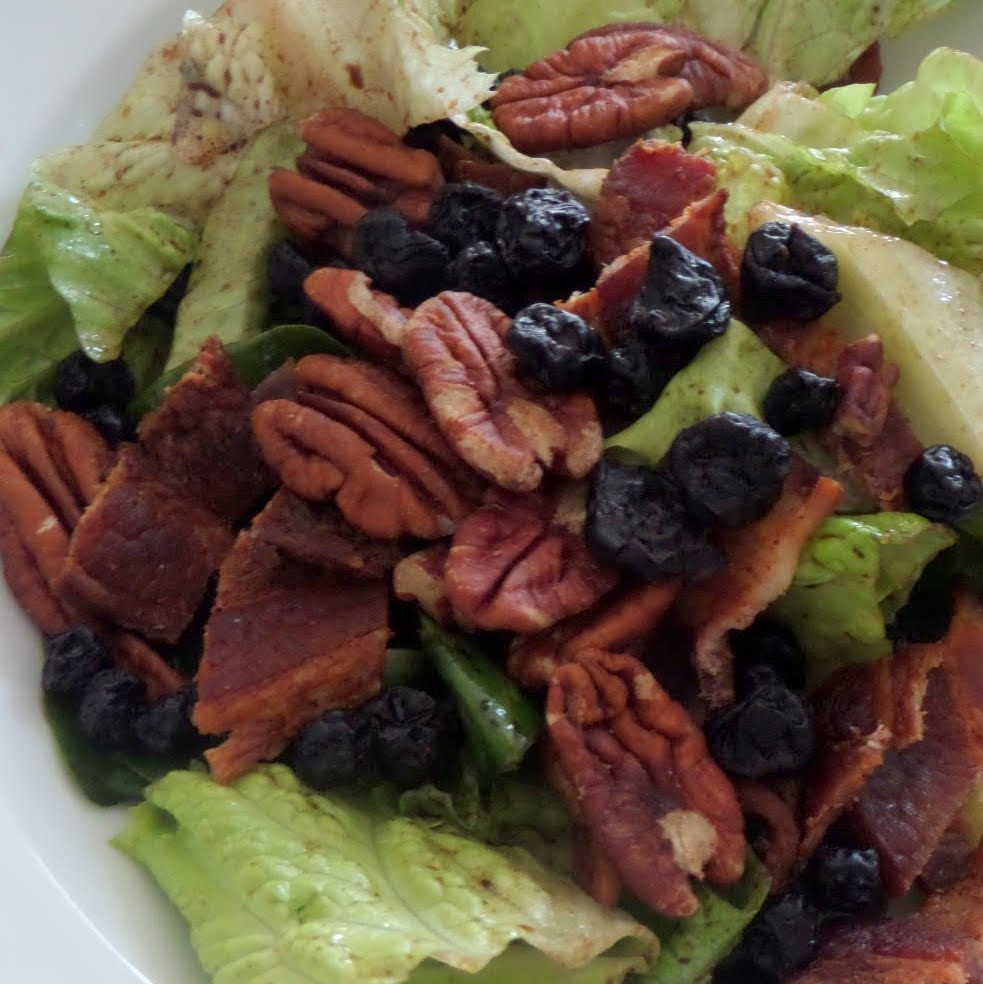 Bacon Pecan Blueberry Salad:  A green salad tossed in a balsamic vinaigrette and topped with bacon,  pecans,and blueberries.