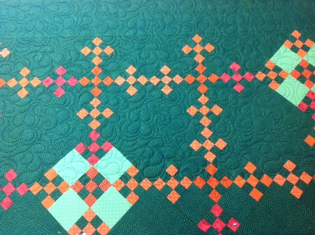 koolkat s quilting blog: Feather pattern on Amish-inspired quilt