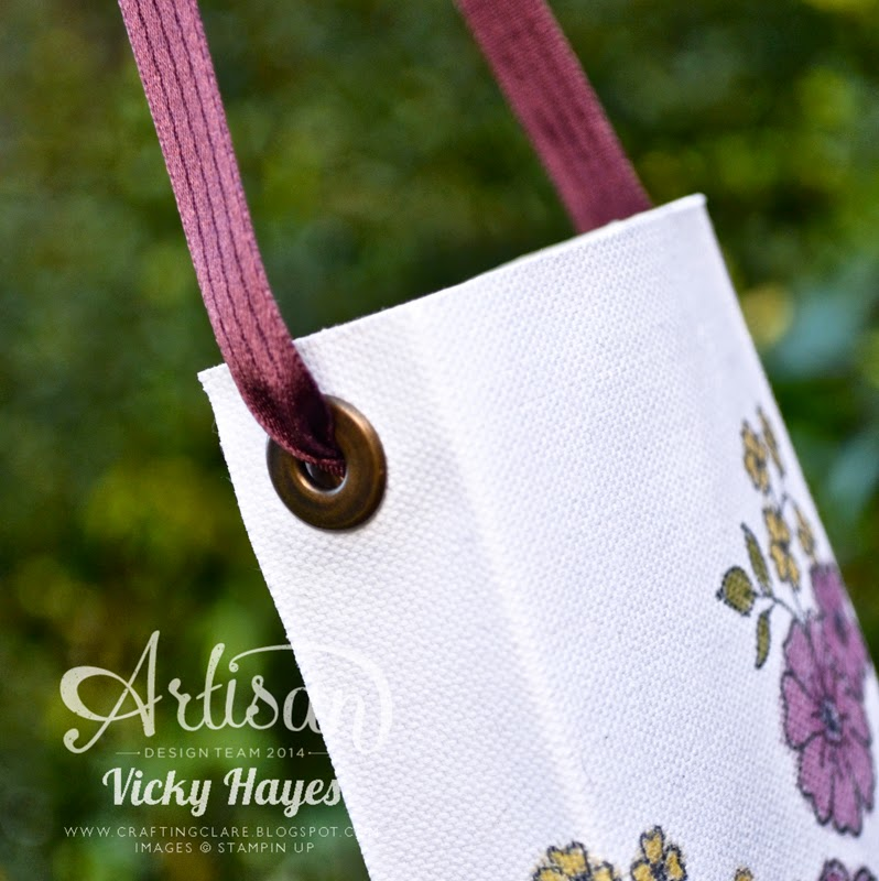 Gift bag handles made from ribbon in Blackberry Bliss by Stampin' Up