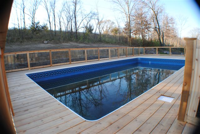 Penguin Pools Inground Pool Built Into Slope And Decked