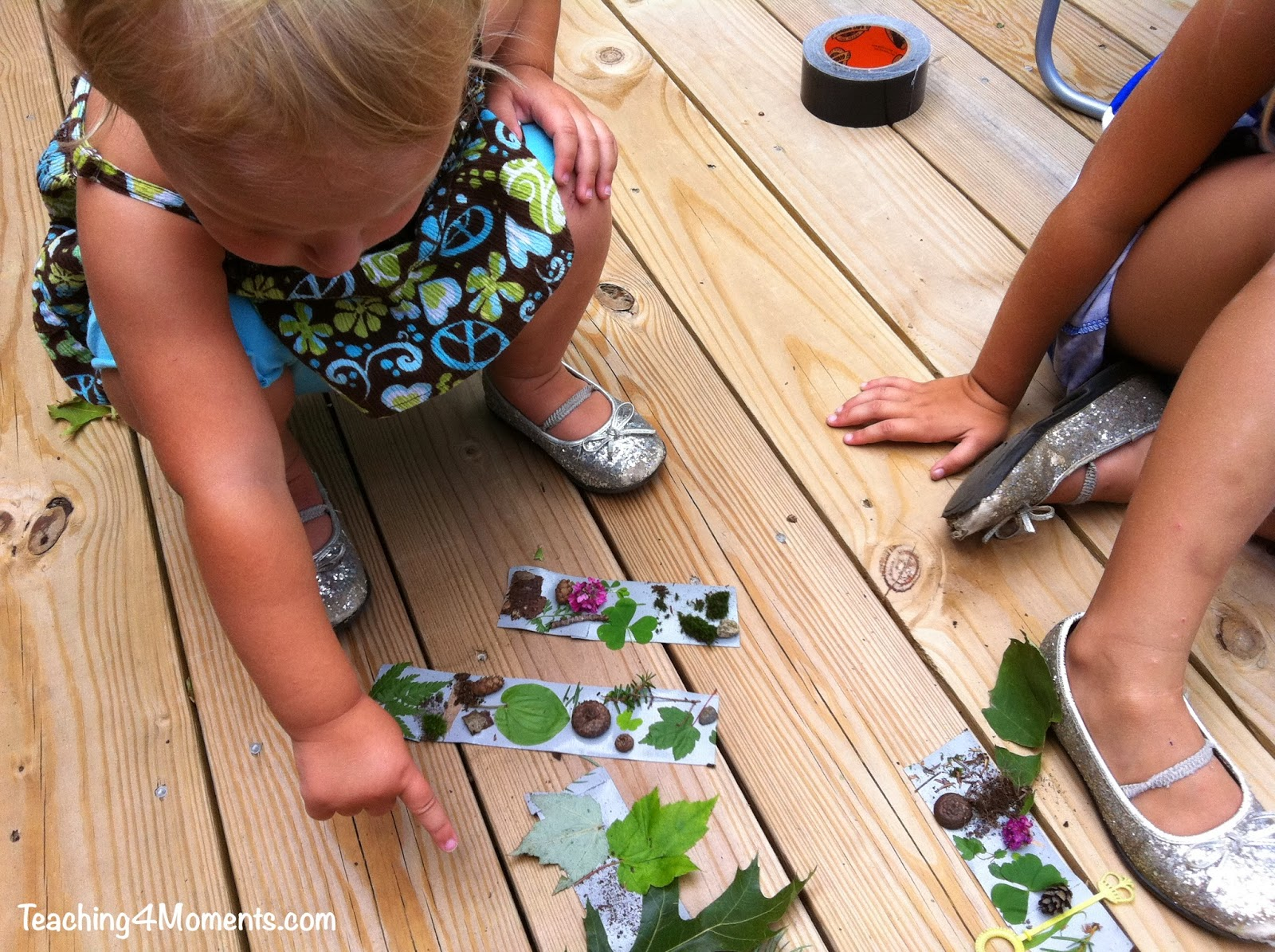 """Teaching 4 Moments-Examining the """"finds"""" from our duct tape bracelet nature walk"""