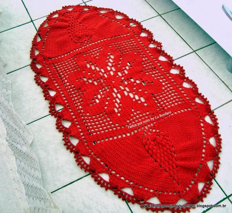 Tapete oval vermelho