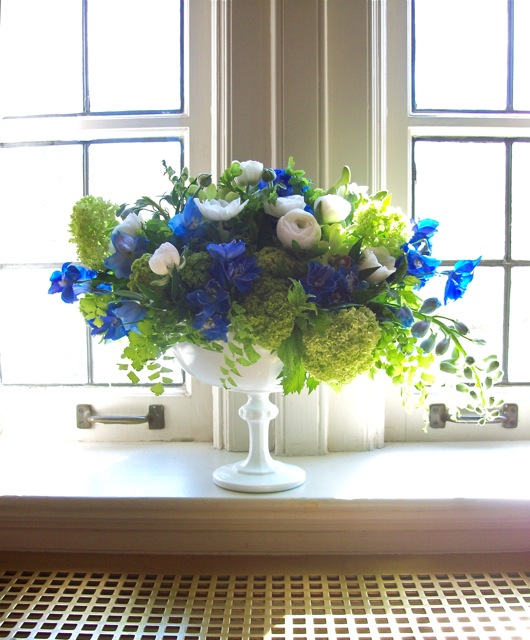 sweet pea floral design michigan wedding florist milk glass compote white anemone black center blue and green centerpiece delphinium, viburnum, orchid, ranunculus, maidenhair fern, jasmine vine, vintage u of m wedding, the michigan league