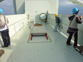 Observation platform on top of one of the main towers of the Akashi Kaikyo bridge, the tour guide is operating the hatch in the floor. It is 289 meters above the ocean