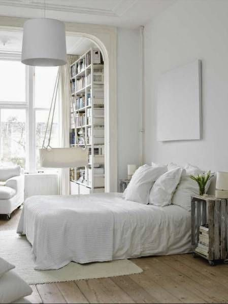 white on white bedroom with crate bedside table and hanging cradle