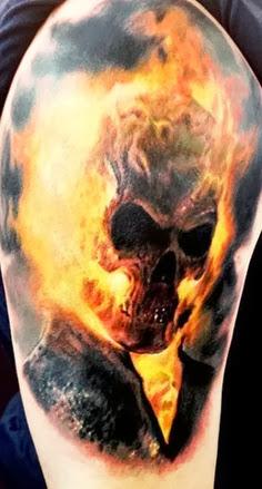 Horror skull with fire tattoo on leg