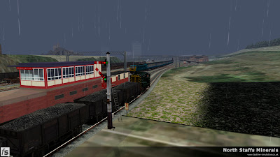 Fastline Simulation - North Staffs Minerals: A Class 10 0-6-0 diesel shunter prepares to haul loaded 24 1/2 ton coal wagons from Wolstanton Colliery Exchange Sidings across the mainline to Grange Sidings as Class 86 86260 passes with a down express to Manchester Picadilly in North Staffs Minerals a route for RailWorks Train Simulator 2012.