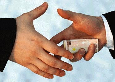 Hand shake that hides a graft payment