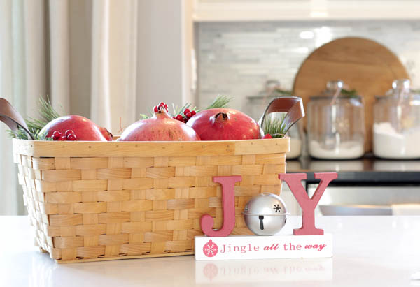 pomegranates inside basket as kitchen island centerpiece for Christmas