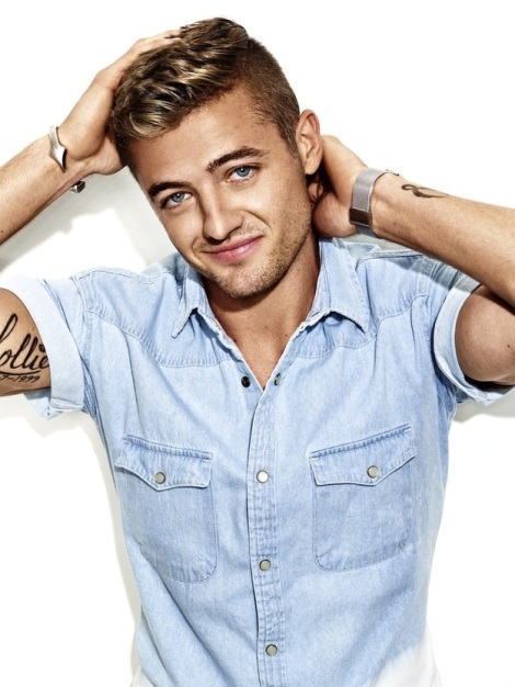 Robbie Rogers flexing muscles in OUT Magazine