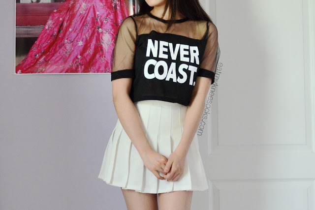 "For under $3, this ""Never Coast"" mesh crop top from Dresslink is stylish and comfortable."
