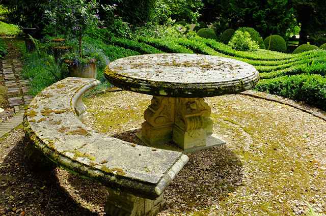 Old stone table and bench in beautiful garden