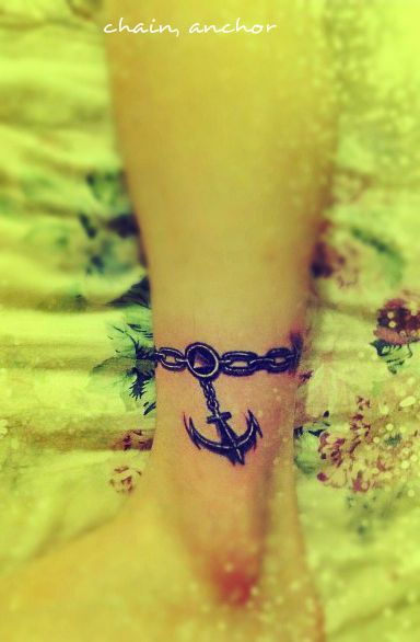 an anchor tattoo design with chains on the ankle