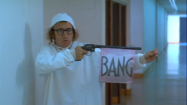Woody Allen stealing the leader's nose with a fake gun in Sleeper
