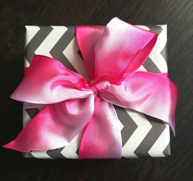 Gift tied with pink ombre bow