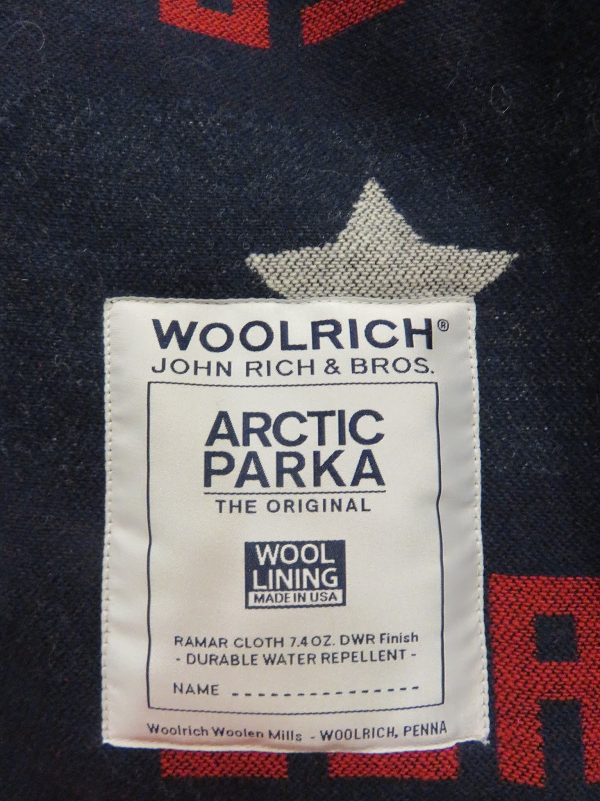 woolrich arctic parka vs canada goose