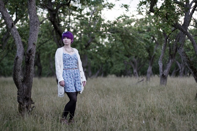 girl with purple hair in an orchard
