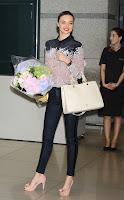 Miranda Kerr posing for cameras at Incheon International Airport
